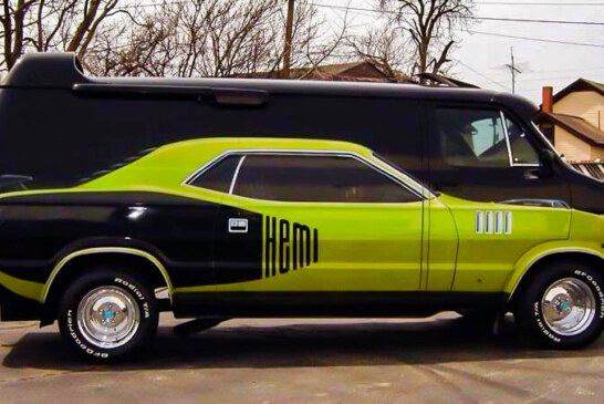 Plymouth Cuda On The Side Of A Custom Van